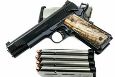 Wilson Combat 1911 Love this but it looks like it is an unfinished product. If you look at the gun itself and at the grips it seems as if something is missing. We would have created something along the edges to tie it in with the gun as it exists. ~ LRM & Her Darling