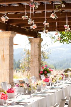 Pink + Yellow Baby Shower, hanging flowers, pillars, wood, table settings, bouquets, baby shower ideas