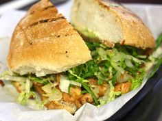 A Sandwich a Day: Torta Pollo at L' Patron. the torta is filled with exceptionally juicy hunks of chicken, which have nice char marks from the grill. A heap of crunchy lettuce adds texture, while some creamy refried beans help keep everything together. #logansquare  #chicago