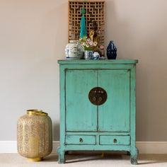 This beautiful Chinese cabinet has been hand-finished in a vivid aqua marine blue lacquer. The oriental legs add style to this wooden lacquered cabinet which offers cupboard and drawer storage. The height and size make it an ideal small drinks cabinet or perhaps bathroom storage. This tall cupboard houses a removable shelf.