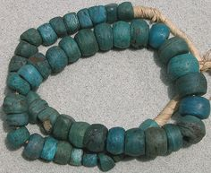 A strand of blue Hebron beads dating to the late 1700`s and originating from The Dead Sea. | They were imported into Nigeria in the early 1900`s by the Hauser traders. | Usually very eroded and gnarly in appearance.  Blue Hebrons are the most difficult to find, with Green in second place, and yellow being the most 'common'.