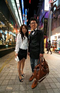 """This is a Seoul street fashion/Korean """"environmental portrait."""" This style conveys not just what people are wearing, but who they are and where they belong in the cultural landscape. Visit our site for this and more kinds of Korean fashion at www.feetmanseoul.com."""