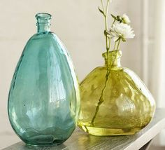 Two stunning hues join the artfully lopsided recycled glass Aqua and Citrine Balloon Vases to create a dramatic seasonal accent