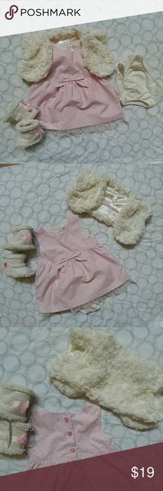 """Cherokee light pink dress w/ fur and bloomer Light pink short sleeve dress with tulle at the bottom. The dress has a cream color pattern on it. Includes a cream color short sleeve fur with a one button close. Fur is so soft. 🐇  Dress is 5 buttons close at back. Decor bow at front. I'm throwing in  one pair of cream  fur boots with a pink & white polka dot bow. The boots are """"Carter just one you""""... I have a size NB & size 2. Please tell me what size you prefer. The boot match great with the…"""