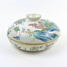 A Chinese porcelain sweetmeat dish and cover, 19th century. A Chinese porcelain sweetmeat dish and cover, 19th century. The heavily potted dish of circular form is divided into six compartments comprising of a circular central section surrounded by five curved sections radiating to the outer edge with the cover functioning as a bowl with a raised foot. The exterior is decorated with overglaze enamels depicting figures in a mountainous setting with pavilions and pagodas with the interior ...