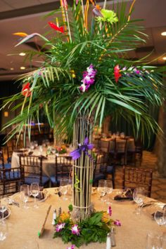 A combination of elephant ears and tropical flowers were used in these great Bar Mitzvah centerpieces. | MitzvahsMarket.com