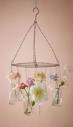 Fashioned out of wire and glass bottles for filling with bright blooms, this whimsically sweet chandelier will look lovely anywhere you decide to hang it.