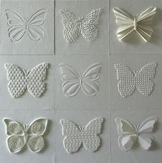 white on white butterflies ... same shape but various texture techniques  ... negative cut outs .. embossing ... pleating ... quilling ... delightful array!!