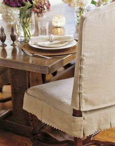 Bored of the same old, beige dining chair? We have just the makeover hacks to create your very own custom dining chair covers. Dining Room Chair Slipcovers, Dining Room Chair Covers, Dining Room Chairs, Slip Covered Dining Chairs, Seat Covers For Chairs, Kitchen Chairs, Chair Back Covers, Wood Chairs, Office Chairs