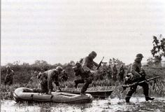 """The Battle of STALINGRAD. Infantry soldiers of Germany crossed the swamp in the River Don up to 6. Armee to Stalingrad, 1942 during the summer of the year. They used small inflatable boats (Schlauchboote), 3 meters in size and accommodate three people, also helped the wooden boats that are """"borrowed"""" from local residents."""