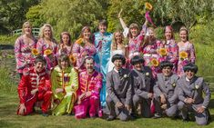 Love is all you need! Music fans tie the knot in Beatles-themed wedding featuring Abbey Road cake, Sgnt Pepper best men, flower power bridesmaids...and a groom dressed as Paul McCartney