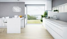 Gray walls and white cabinetry keep this kitchen from overpowering the amazing view.