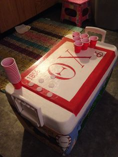Minus the mini beer pong Fraternity Crafts, Fraternity Coolers, Frat Coolers, Theta Chi, Sigma Chi, Mini Beer Pong, Formal Cooler Ideas, Greek Crafts, Coolest Cooler
