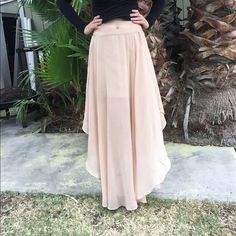Semi-sheer maxi skirt Beautiful semi sheer maxi shirt that is a nude/tan color. Has an interesting hem-it is Lon in the front and back and short on the sides. Has a mini skirt lining on the inside with a zipper and hook and eye closure in the back. Forever 21 Skirts Maxi