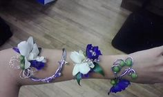 One of a kind arm corsage for prom made by ME. White orchids, blue delphinium, green hypericum berries