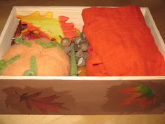 Box for storage of nature table items. Decorate appropriately for each season (this one is Autumn)