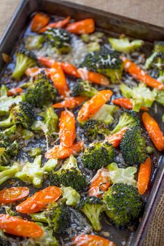 Parmesan Roasted Vegetables are an easy way to make an indulgent side dish with just a couple of points! Made with broccoli and carrots, they're crispy, tender, salty and rich from the Parmesan cheese.