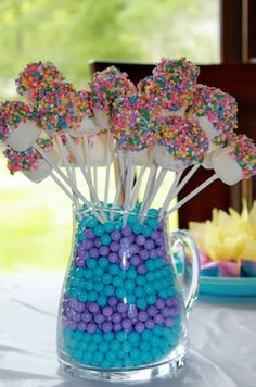 Great and cute way to display your cake pops or marshmallow pops. Just fill a pitcher with cute and colorful candy and then place the pops to look like a candy bouquet!