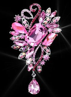 Pretty pink brooch.