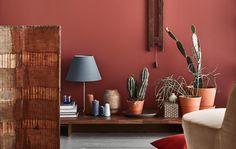 Myslíme si, že kombinácia zemitých červených farieb s modrými akcentmi a nábytkom z tmavého dreva je výrazný nadchádzajúci trend.