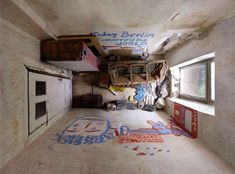 Menno Aden takes aerial photographs of corner stores, bedrooms, dental offices, and other interiors.