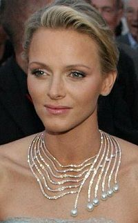 Princess Charlene of Monaco wearing the Infinite Cascade Necklace ~ a massive creation of Lebanese jeweler Tabbah, composed of pearls and diamonds: a gift from Prince Albert but Charlene was involved in the design
