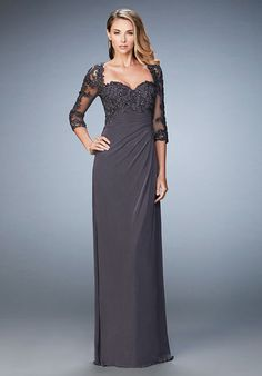 Sultry satin dress with off the shoulder sleeves. Unique sweetheart neckline embellished with beaded lace and a satin belt. Back zipper closure. Evening Collection Size Chart B.