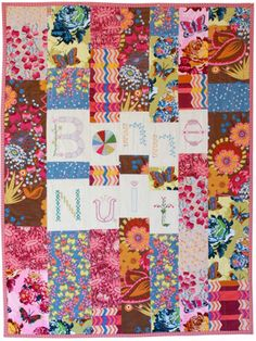 bonne nuit quilt by anna maria horner    embroidery, bright colors, florals, *velvet* - amazing quilt, and so simple!  Just some rows of large blocks.
