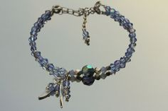 Angel Wing Bracelet Sapphire Blue Swarovski Elements Crystals Karen Hill Tribe Faceted Silver Beads and Delicate Angel Wings Sterling Silver