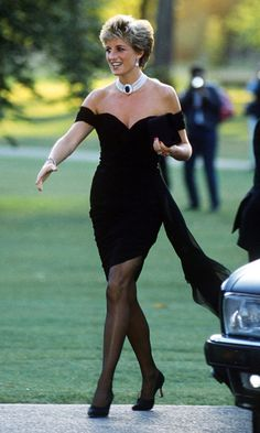"The same evening that a documentary aired in which Charles admitted that he had been unfaithful to her during their marriage, Diana donned her infamous ""revenge dress"" for a <i>Vanity Fair</i> dinner at the Serpentine Gallery close to Kensington Palace. The short off-the-shoulder silk-chiffon dress was designed by a then-relatively unknown Greek designer named Christina Stambolian. <br><p>Photo: © Getty Images</p>"