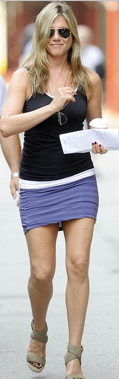 Who made  Jennifer Aniston's gold aviator sunglasses, purple skirt, and tan wedge sandals that she wore in New York?