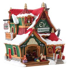 "Lemax The Elf Workshop. The Elf Workshop by Lemax brings the magic of Christmas to your place. Proudly flying the banner ""Expert Toy Makers"" . Christmas Elves know how to have fun and do a great job at the same time. Village Lemax, Lemax Christmas Village, Christmas Town, Magical Christmas, Christmas Gingerbread, Christmas Villages, Christmas Crafts, Christmas Decorations, Christmas Mantles"