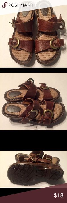 B.O.C. Brown Leather Buckle Straps Sandals. Brown Leather 2 buckle straps over the foot. One buckle has a little damage. Leather upper balance man made material. Little to no signs of wear on shoes and bottoms. B.O.C. Shoes Sandals