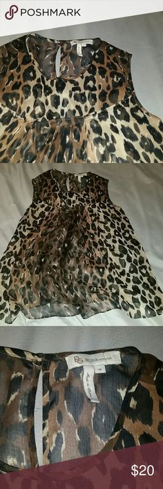 BCBGeneration sleeveless leopard print blouse BCBGeneration sleeveless, leopard print blouse. Blouse is sheer/chiffon and very flowy. Has a small keyhole in the back. Tops Blouses