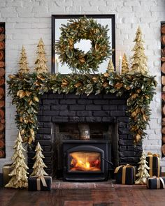 Holiday Decorating Ideas Bring a touch of woodland elegance to your living spaces. Golden magnolia leaves and charming fairy lights create an enchanting holiday scene. Silver Christmas Decorations, Tabletop Christmas Tree, Christmas Signs Wood, Christmas Mantels, Rustic Christmas, Christmas Wreaths, Christmas Villages, Victorian Christmas, Christmas Christmas