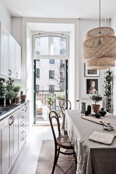 Mornings in this kitchen wouldn't be so bad! Splashes of colour, plants, and natural light mean the neutral tones don't become dreary.