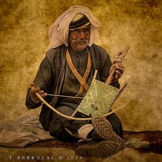 Rebaba; A stick fiddle, played vertically with a bow. Part of the oud family, typically has 2 or 3 strings. There are two basic types of rebaba: wooden fiddles with pear-shaped bodies, and spiked fiddles, named for the spike on the bottom of the instrument on which it stands while being played. Spiked rebabs typically have no frets, but instead, the fingers of your left hand become movable bridges. These instruments complement the melodic line by creating a dialogue with the singers.
