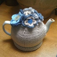 Wow, I was just talking to my mum about making her a grey & blue tea cosy to go in her kitchen. .