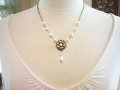 Would go with my dress perfectly :)    BELLISIMO  Swarovski Pearl and Antiqued Brass by Yourstocherish, $36.00