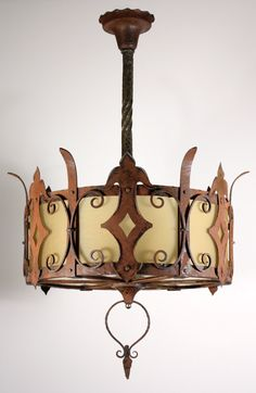 A striking antique Arts and Crafts six-light chandelier with its original amber glass, circa 1905.