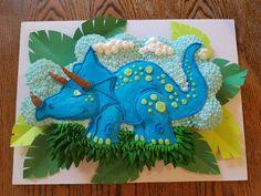 A dinosaur cupcake cake. A dinosaur cupcake cake. Dinosaur Cupcake Cake, Dino Cake, Cupcake Cakes, Pull Apart Cupcake Cake, Pull Apart Cake, Dinosaur Birthday Party, 4th Birthday Parties, Third Birthday, Boy Birthday