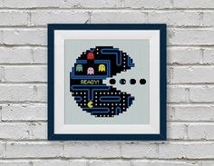Little 8 year old me is screaming their head off right now because of this amazing PacMan Cross Stitch Pattern by StitchLine!