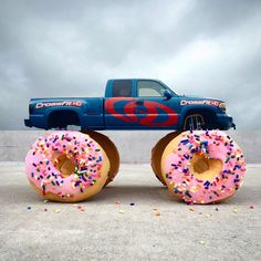 monster truck + donuts.  another cloudy day on the east side. consider this my attempt at bringing a little sun/fun to the party. and personally I think it would behoove the dunkin' donuts corporation to construct such a vehicle. more #combophoto's ⬅️ here. and an outtake at @combophotofail. #monstertruck #truck #donut #vscocam