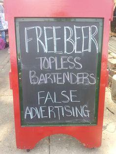 """Free Beer...Topless Bartenders...False Advertising.""  Funny bar advertisement in Memphis."