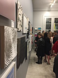 Guests admire pieces from Bay Area artists for auction to benefit Enterprise for High School Students.