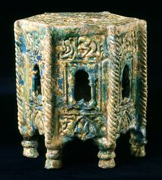 Fritware table, molded and covered with an opaque, turquoise glaze