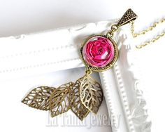 Real Rose Necklace - Rose Pendant, Real Flower Jewelry, Resin Flower Pendant, Dried Flower Pendant, Resin Jewelry, Romantic Jewelry  Thank you for your interest in La Tania Jewelrys real flower jewelry. This piece of jewelry is made by me from scratch. I used high quality resin that I placed a dried rose in it. I make all my jewelry with handmade silicone molds in which I pour the resin, Then the resin cabochon ware neatly sanded and polished.  The beautiful necklace is the perfect match…