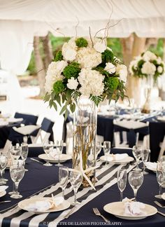 Great Centerpiece flower arrangement for  Nautical theme Reception at Key Largo Lighthouse Beach Wedding Venue in the Florida Keys