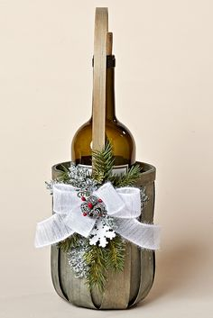 Grey Wine Basket with Snowy Pine, Tiny Pine Cones with Red Berries, a Snowflake and a White Bow, From the Snowy Christmas Collection