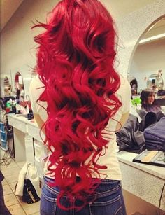 nikkis hair color when she dyes it one of the reds. and her hair when she curls it
